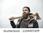 hipster with beard on serious... | Shutterstock . vector #1104407699