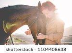 young farmer woman hugging her... | Shutterstock . vector #1104408638