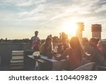 young friends having barbecue... | Shutterstock . vector #1104409829