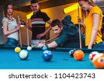 group of friends playing pool | Shutterstock . vector #1104423743