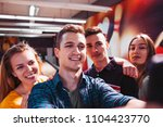 friends taking selfie at... | Shutterstock . vector #1104423770