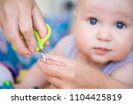 close up mother cutting nail of ... | Shutterstock . vector #1104425819