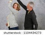 happy elderly couple dancing...   Shutterstock . vector #1104434273