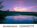 magical purple sunrise over... | Shutterstock . vector #1104435779