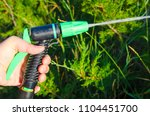 hand with water spray jet in... | Shutterstock . vector #1104451700