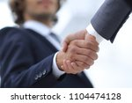 Small photo of Shake hands, agreed to between the two men in the businesses.