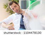 office employee feeling... | Shutterstock . vector #1104478130