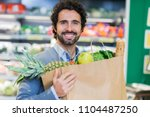 man holding food bag in a...   Shutterstock . vector #1104487250