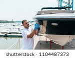 boat maintenance   man with... | Shutterstock . vector #1104487373