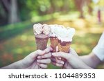 women hand holding an ice cream ... | Shutterstock . vector #1104489353