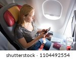 woman on commercial passengers... | Shutterstock . vector #1104492554