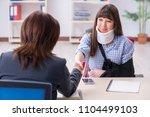 injured employee visiting... | Shutterstock . vector #1104499103