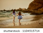 happy two little girls have fun ... | Shutterstock . vector #1104515714