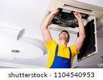 repairman repairing ceiling air ... | Shutterstock . vector #1104540953