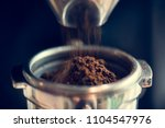 closeup of fresh grinding coffee | Shutterstock . vector #1104547976