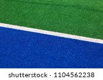 sideline of a synthetic hockey... | Shutterstock . vector #1104562238