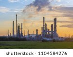 refinery at the morning | Shutterstock . vector #1104584276