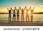 silhouette of group young... | Shutterstock . vector #1104618878
