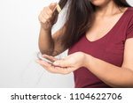young woman worried about hair... | Shutterstock . vector #1104622706