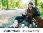 couple sitting on bench... | Shutterstock . vector #1104626249