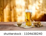 glass of beer with wheat on a... | Shutterstock . vector #1104638240