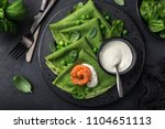 spinach crepes with smoked... | Shutterstock . vector #1104651113