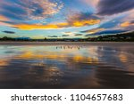clouds are reflected in the...   Shutterstock . vector #1104657683