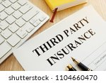 Small photo of Third Party Insurance form on a desk.