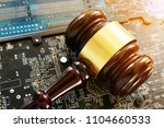 gavel and electronic devices.... | Shutterstock . vector #1104660533