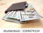 heap of money and wallet. money ...   Shutterstock . vector #1104674114