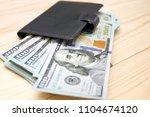 heap of money and wallet. money ...   Shutterstock . vector #1104674120