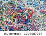 the bunch of electric wires of... | Shutterstock . vector #1104687389