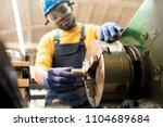 confident african american... | Shutterstock . vector #1104689684