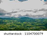 clouds and sky with small town... | Shutterstock . vector #1104700079