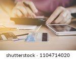 woman hand calculating  her... | Shutterstock . vector #1104714020