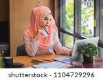 a muslim woman holds a credit... | Shutterstock . vector #1104729296