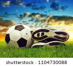 soccer ball and shoes on... | Shutterstock . vector #1104730088