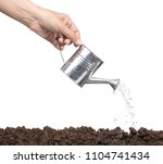 hand pouring from  aluminuim... | Shutterstock . vector #1104741434