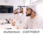 arabian men meeting and talking ... | Shutterstock . vector #1104743819