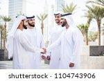 arabian men meeting and talking ... | Shutterstock . vector #1104743906