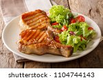 grilled pork steak with a bone... | Shutterstock . vector #1104744143