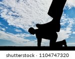 silhouette of a large leg... | Shutterstock . vector #1104747320