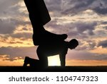 silhouette of a large leg... | Shutterstock . vector #1104747323