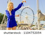 fashionable woman wearing blue... | Shutterstock . vector #1104752054