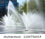 Spray from the fountain in the city as a background - stock photo