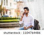 young handsome indian man speak ... | Shutterstock . vector #1104764486
