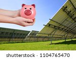 solar panels and piggy bank in... | Shutterstock . vector #1104765470