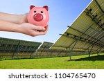 solar panels and piggy bank in... | Shutterstock . vector #1104765470