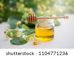 jar of fresh honey with flowers ... | Shutterstock . vector #1104771236