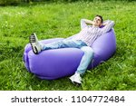 handsome young man lying on... | Shutterstock . vector #1104772484